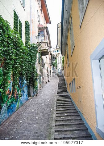Zurich, Switzerland - August 9, 2007: Downtown City With Empty Narrow Street And Alley By Residentia