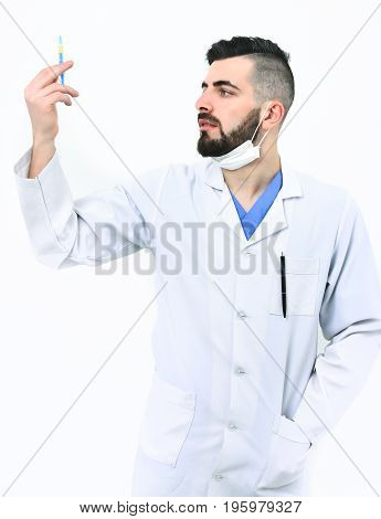 Dentist With Beard Holds Syringe And Looks At It Attentively