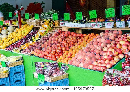 Montreal Canada - July 26 2014: Produce on fruit stand with signs in French at Jean-Talon farmers market with nectarines and peaches