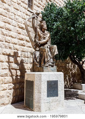 Jerusalem Israel July 14 2016 : The statue of King David with harp near entrance to his tomb on Mount Zion in Jerusalem Israel