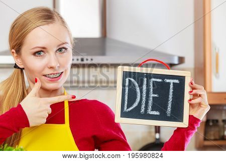 Happy Woman Holding Board With Diet Sign