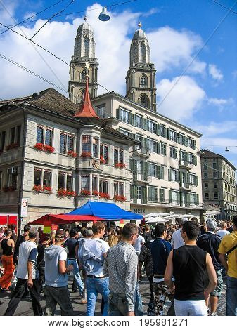 Zurich, Switzerland - August 11, 2007: Techno Street Parade With Crowd Of Many People And Church Arc