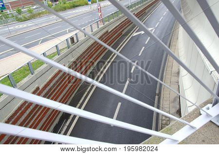 View of a curvy road outside of the tunnel through the bridge