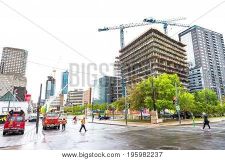 Montreal, Canada - May 26, 2017: Buildings In Downtown Area Of City In Quebec Region With Constructi