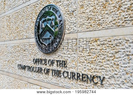 Washington Dc, Usa - July 3, 2017: Office Of The Comptroller Of Currency Sign And Logo In Downtown