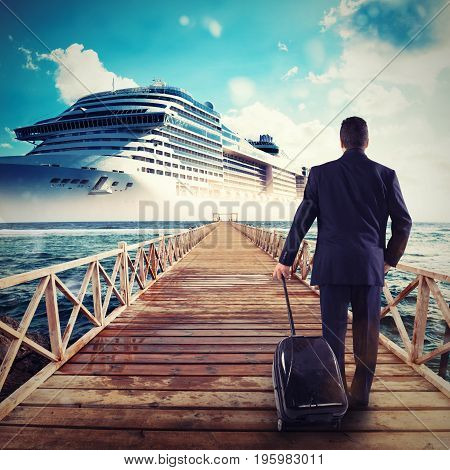 Man boarding on a cruise ship carrying his trolley