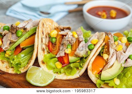 Fajitas with chicken vegetables and spicy sauce salsa.
