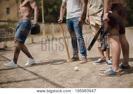 group of young multiethnic male baseball players on court