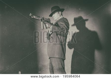 Antique Black And White Photo Of Film Noir Gangster Shooting With Gun.