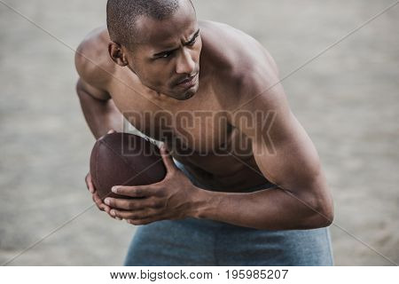Young Handsome African American Male Football Player With Ball