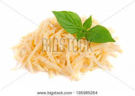 Heap of grated cheese with basil leaves isolated on white background.