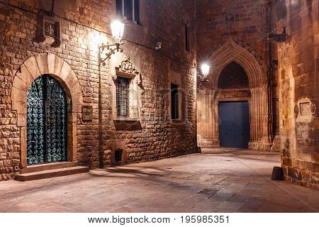 Cobbled empty medieval street in Barri Gothic Quarter at night, Barcelona, Catalonia, Spain