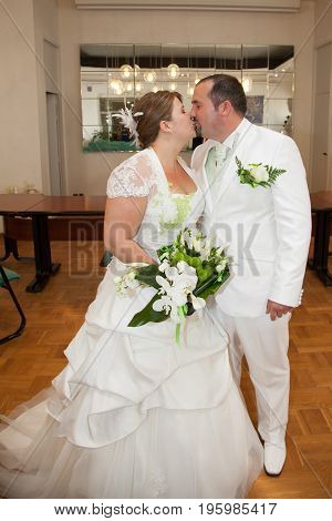Groom And Bride Kissing After The Wedding Ceremony On Hall Town