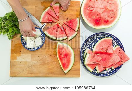 a women cutting water melon in home