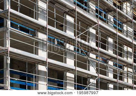 construction site scaffolding on building facade -