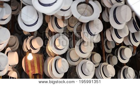 Collection of White Fedora Hats with Blue and Silver band merchant storefront