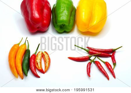 Mix color Red green yellow sliced chilli bell and bird's eye pepper isolated on white background