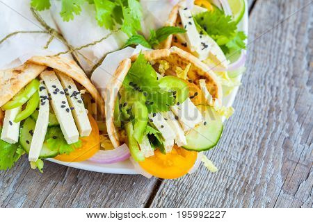 Vegan wrap or fajitas with tofu and fresh vegetables. Love for a healthy vegan food concept.