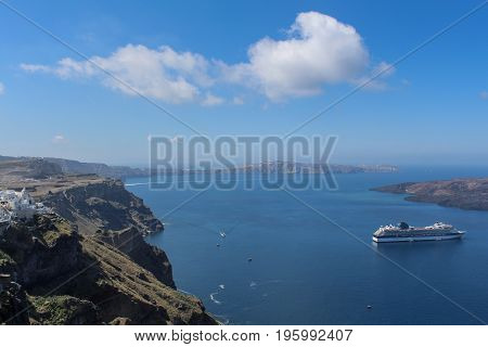 Panoramic view from the mountain to the small town below on Thira Island. Santorini, Greece.