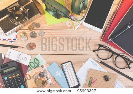 Traveler Object, Passport, Euro Coin, Euro Banknote, Headphones, Passport, Touristic Map. Top View T