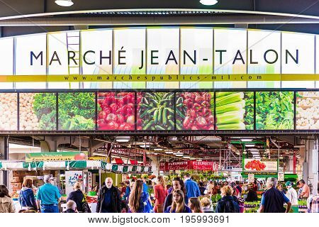 Montreal Canada - May 27 2017: Jean Talon market sign and entrance with people in Little Italy neighborhood in city in Quebec region