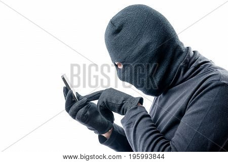 Portrait Of A Hacker With A Stolen Mobile Phone On A White Background