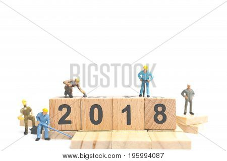 Miniature Worker Team Building Number On Wooden Block