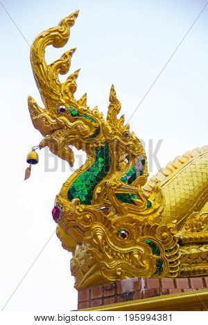 Naga on the roof of Wat Tai Phra Chao Yai Ong TueUbonratchathani ProvinceThailand.