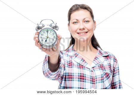 7 Am On The Dial Of An Alarm Clock In A Female Hand, An Alarm Clock In Focus On A White Background