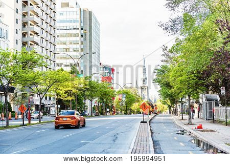Montreal, Canada - May 27, 2017: Boulevard Rene-levesque With Separate Bicycle Lanes And View Of Sai