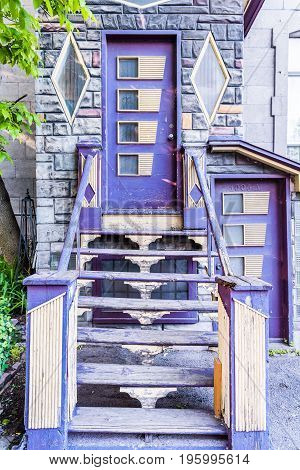 Montreal Canada - May 27 2017: Colorful purple building entrance to apartment stairs on Saint Hubert street in city in Quebec region
