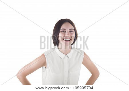 A cheerful and cute young woman with a short haircut and in a white blouse, isolated on a white background. A happy brunette lady with a pretty charming smile. A successful business worker looks happy
