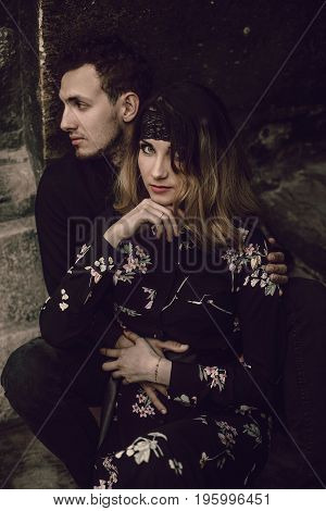 Stylish Gypsy Couple In Love Posing In Evening City Street At Old Building. Woman And Man Embracing,