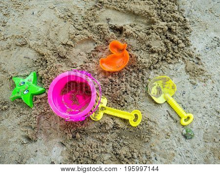 Toys for sand digging it have a beautiful color Lay on the sand.