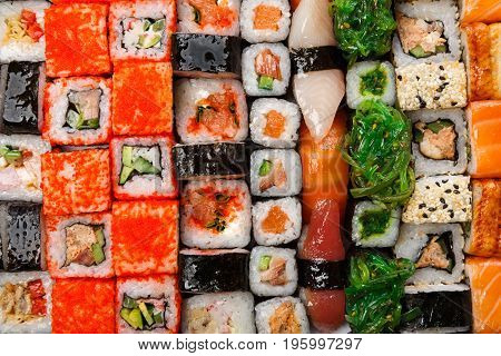 Sushi and rolls pattern background, japanese restaurant delivery top view. Salmon, unagi, california and other healthy meals