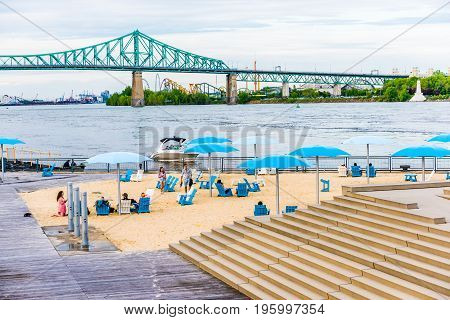 Montreal, Canada - May 27, 2017: Old Port Area With Sandy Beach, Umbrellas And Boats In City In Queb