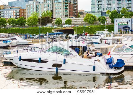 Montreal, Canada - May 27, 2017: Old Port Area With Closeup Of Boats In Harbor With People Having A