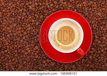 Empty Latte In Red Cup And Saucer On Coffee Beans