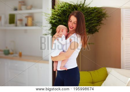 Happy Young Mother Holding Little Infant Baby
