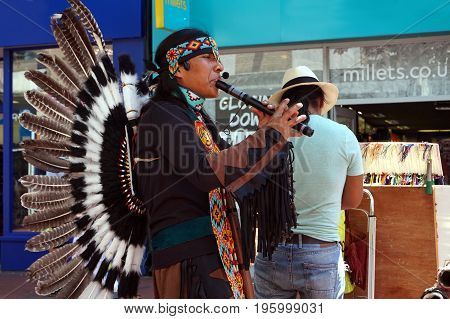 Reading, Uk - June 17Th 2017: Native South American Flute Player In Traditional Costume With Feather