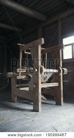 Old age wooden loom machine - vertial, close up