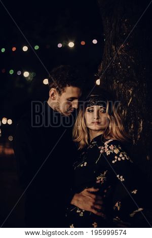 Passionate Gypsy Bride And Groom Lovers Embracing In Evening City Street. Stylish Couple In Love Gen
