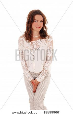 A beautiful young woman standing with her hands between her legs needs a restroom isolated for white background.