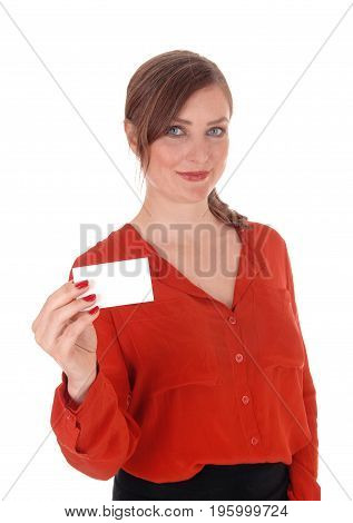 A beautiful woman in a red blouse and brunette hair holding an empty business card up smiling isolated for white background.