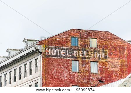 Montreal, Canada - May 27, 2017: Old Town Area With Closeup Of Hotel Nelson Sign On Brick Wall In Qu