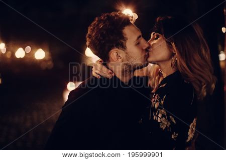 Passionate Lovers Sexually Kissing In Evening City Street. Stylish Gypsy Couple In Love Embracing In