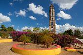 Manaca Iznaga old slavery tower near Trinidad Cuba. The Manaca Iznaga Tower is the tallest lookout tower ever built in the Caribbean sugar region. poster