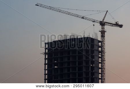 New Building,new Construction.unfinished Building.construction Crane With Unfinished Building On Sky