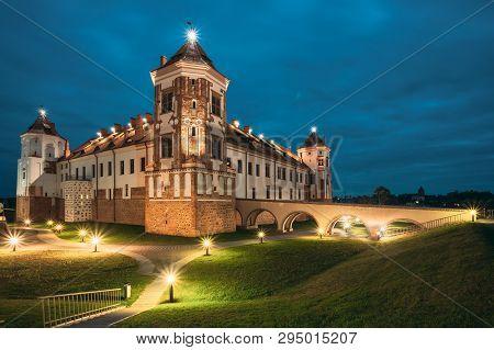 Mir, Belarus. Castle Complex Mir In Evening Or Night Illumination. Cultural Monument, Unesco World H