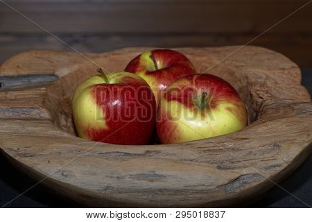 Three Apples In A Wooden Bowl. Torfhaus, Germany